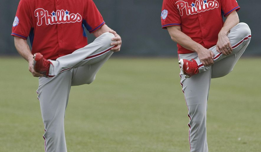 FILE - In this Feb. 24, 2015, file photo, Philadelphia Phillies pitchers Cliff Lee, left, and Jonathan Papelbon stretch during the team's first full-squad workout, at baseball spring training in Clearwater, Fla. Lee, who made his final start of 2014 on July 31 because of a strained left elbow, starts for Philadelphia against Houston in Kissimmee, Fla. (AP Photo/Steve Nesius, File)