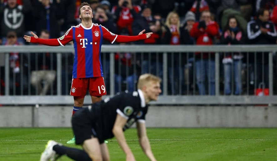 Bayern's Mario Goetze celebrates after scoring his side's second goal during the German Soccer Cup round of sixteen match between FC Bayern Munich and Eintracht Braunschweig in Munich, southern Germany, Wednesday, March 4, 2015. (AP Photo/Matthias Schrader)
