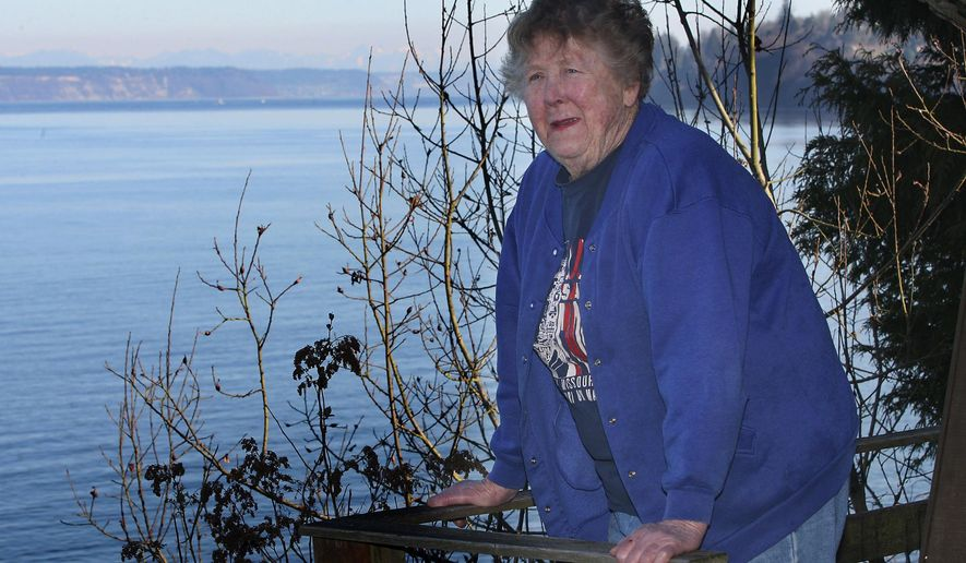FILE - In this March, 2009, file photo, Adele Ferguson looks out from her deck in Hansville, Wash. Ferguson, a pioneering female journalist and a longtime reporter and columnist for the Bremerton Sun, died Monday, March 2, 2015. She was 90. (AP Photo/Kitsap Sun, Carolyn J.Yaschur, File)