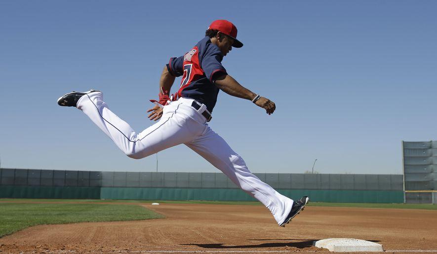 Cleveland Indians' Francisco Lindor runs during spring training baseball practice Thursday, Feb. 26, 2015, in Goodyear, Ariz. (AP Photo/Darron Cummings)