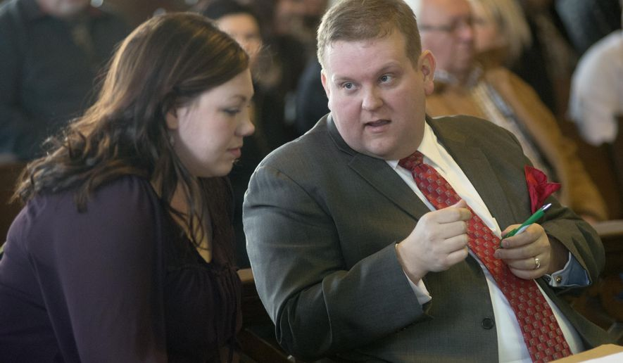 Plaintiff Brandi Bitterman, left, and her attorney Philip Ellison talk in Shiawassee County Circuit Court before the start of an evidentiary hearing regarding the Oakley village reserve police force, Wednesday, March 4, 2015. Shiawassee County Circuit Judge Matthew J. Stewart ruled that the village of Oakley has 30 days to comply with a Freedom of Information Act requesting documents containing information about police reservists. The hearing is regarding the disclosure of reserve officer names in response to a Freedom of Information Act lawsuit by Bitterman. She is seeking the names of reserve officers that the village denied. (AP Photo/The Saginaw News/MLive.com, Jeff Schrier)