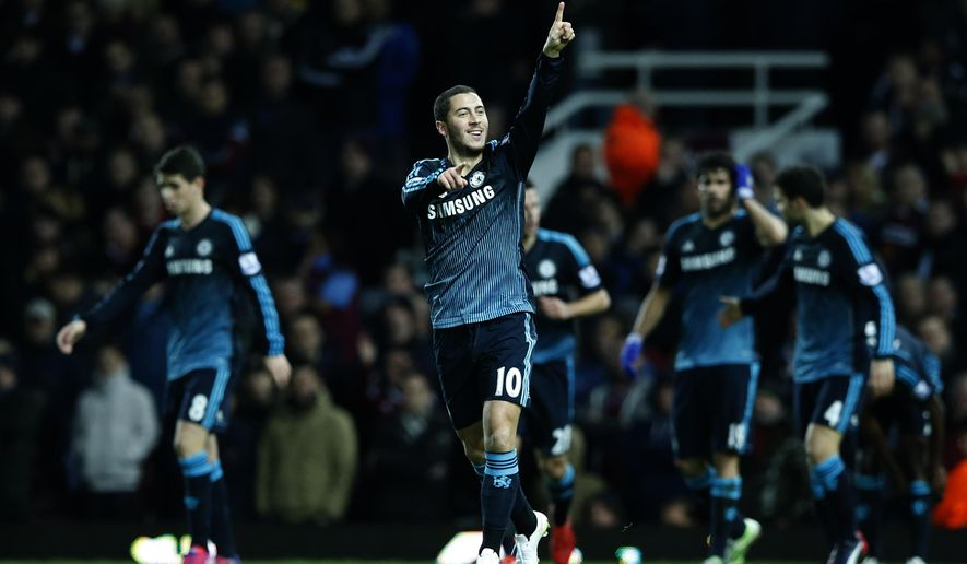 Chelsea's Eden Hazard celebrates after scoring the opening goal of the game during the English Premier League soccer match between West Ham United and Chelsea , at the Boleyn ground in London, Wednesday, March, 4, 2015. (AP Photo/Alastair Grant)