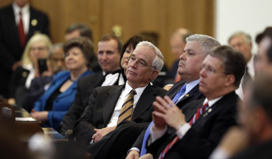 Lawmakers listen on the House floor as Chief Justice Mark Martin delivers the State of the Judiciary address to a joint session of the General Assembly, Wednesday, March 4, 2015, in Raleigh, N.C. (AP Photo/Gerry Broome)