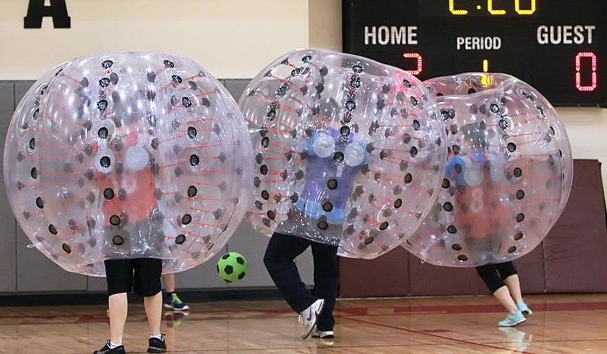 In this photo taken Thursday, Feb. 26, 2015, players bounce off each other during a bubble ball soccer match at Central Washington University's SURC recreation center in Ellensburg, Wash. Thursday was the second time the school has put on the game. The first was during fall quarter. (AP Photo/The Daily Record, Brian Myrick)