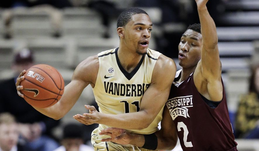 Vanderbilt forward Jeff Roberson (11) is guarded by Mississippi State forward Demetrius Houston (2) in the first half of an NCAA college basketball game Wednesday, March 4, 2015, in Nashville, Tenn. (AP Photo/Mark Humphrey)