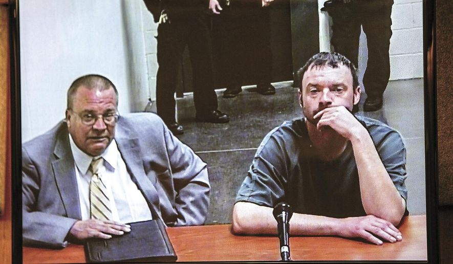 In this photo taken Monday, March 2, 2015, Lucas Rasmussen, right, appears in Cowlitz County Superior Court, in Kelso, Wash., with his lawyer Terry Mulligan for a video hearing for the murder of Alisha McLeod. Rasmussen is charged with murdering McLeod in her Longview, Wash. apartment on Sunday, March 1, 2015. (AP Photo/the Daily News, Bill Wagner)