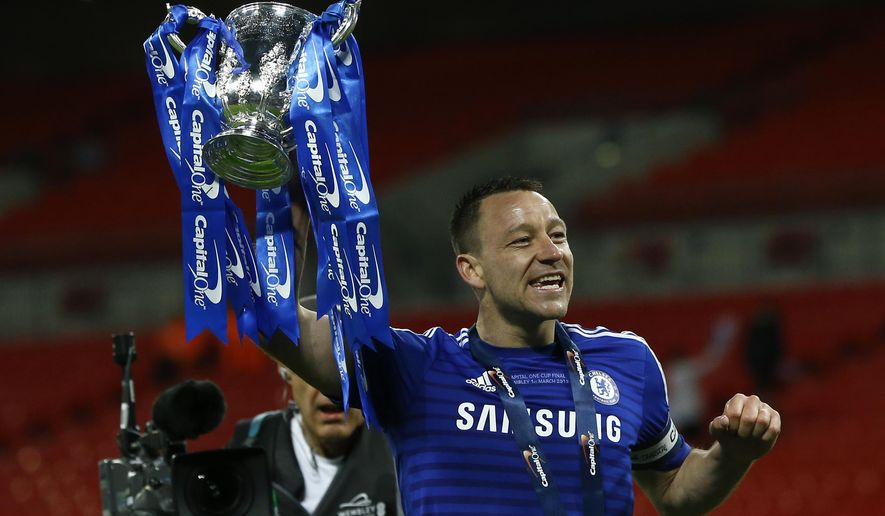 Chelsea's John Terry celebrates towards his teams fans after winning the English League Cup final soccer match between Chelsea and Tottenham at Wembley stadium in London, Sunday, March 1, 2015. (AP Photo/Kirsty Wigglesworth)