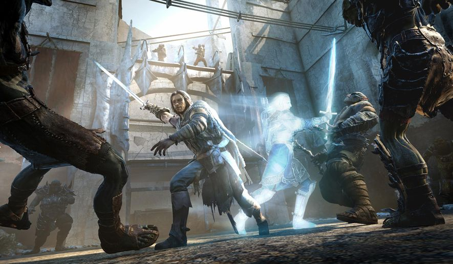 "This image released by Warner Bros. Entertainment shows a ranger named Talion and his ghostly companion invading an orc fortress in a scene from video game ""Middle-earth: Shadow of Mordor."" The legion of orcs from ""Middle-earth: Shadow of Mordor"" will attempt to reign supreme at the Game Developers Choice Awards on Wednesday, March 4, 2015. The role-playing title is nominated for the most awards at the 15th annual ceremony and will face off against ""Alien: Isolation,"" ""Bayonetta 2,"" ""Destiny"" and ""Hearthstone: Heroes of Warcraft"" for the game of the year honor. (AP Photo/Warner Bros. Entertainment, File)"