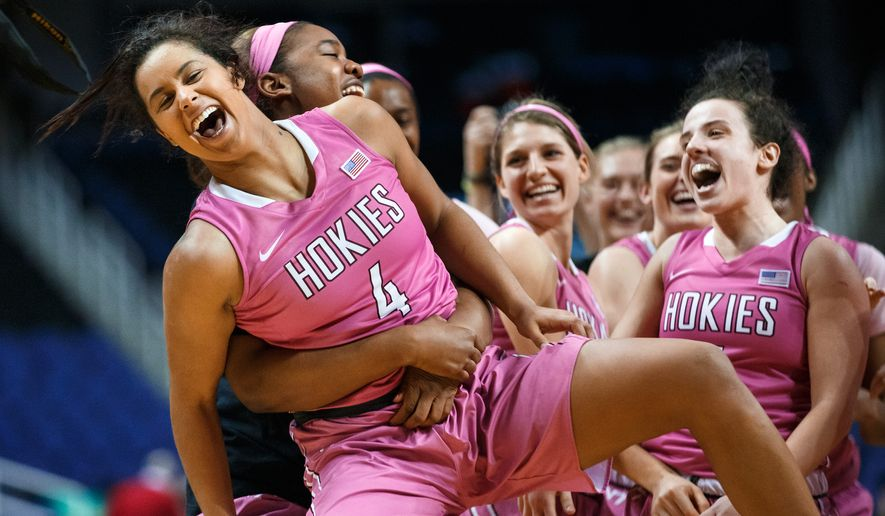 Virginia Tech's Khadedra Croker lifts Hannah Young (4), who hit the game winning shot with less than a second left, after Virginia Tech's 57-56 victory over North Carolina State in an NCAA college basketball game in the Atlantic Coast Conference women's tournament Wednesday, March 4, 2015, in Greensboro, N.C. (AP Photo/News & Record, Jerry Wolford)