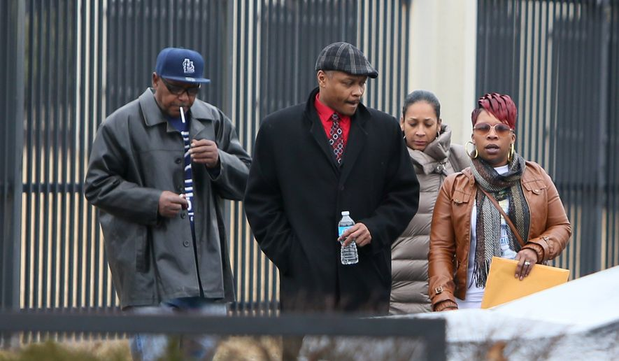 Michael Brown's mother, Lesley McSpadden, far right, leaves the FBI offices in St. Louis after meeting with federal officials on Wednesday, March 4, 2015. (AP Photo/St. Louis Post-Dispatch, David Carson)
