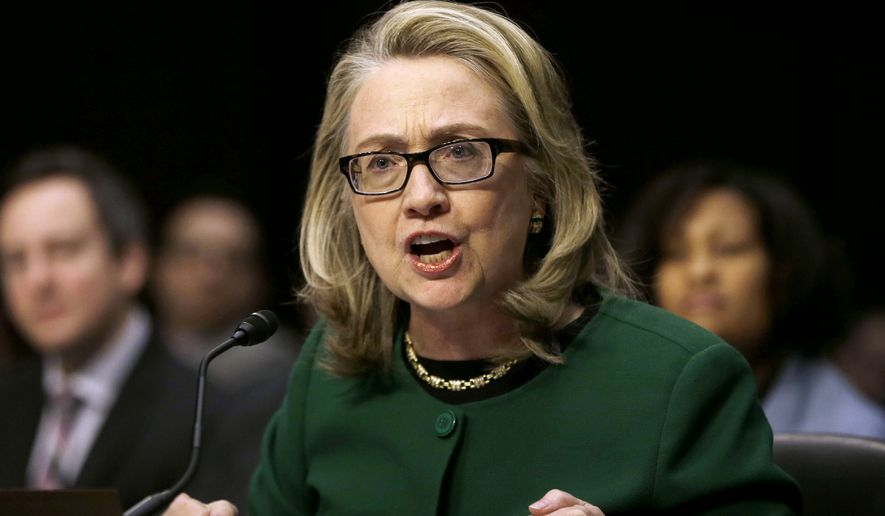 Then-Secretary of State Hillary Rodham Clinton testifies on Capitol Hill in Washington, on the deadly September attack on the U.S. diplomatic mission in Benghazi, Libya, that killed Ambassador J. Christopher Stevens and three other Americans. (AP Photo/Pablo Martinez Monsivais, File)