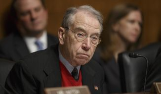 """Whistleblowers are kind of treated like a skunk at a picnic, and I hope you'll do all you can to reverse that,"" Sen. Chuck Grassley, Iowa Republican and chairman of the Senate Committee on the Judiciary, told FBI Associate Deputy Director Kevin Perkins at a hearing Wednesday. (Associated Press)"