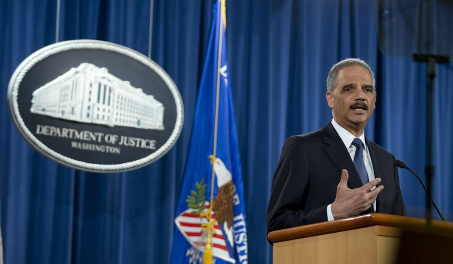 Attorney General Eric Holder speaks at the Justice Department in Washington, Wednesday, March 4, 2015, about the Justice Department's findings related to two investigations in Ferguson, Mo. (AP Photo/Carolyn Kaster)