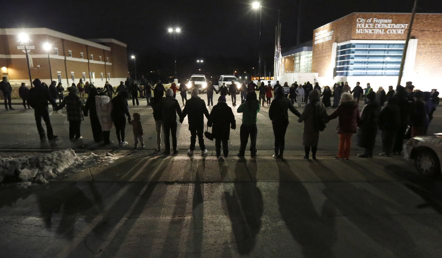 Protestors block traffic outside the Ferguson, Mo., police department, Wednesday, March 4, 2015, in Ferguson. (AP Photo/Charles Rex Arbogast) ** FILE **