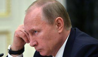 Russian President Vladimir Putin attends a cabinet meeting in Moscow,  Wednesday, March 4, 2015. (AP Photo/RIA Novosti, Alexei Druzhinin, Presidential Press Service)