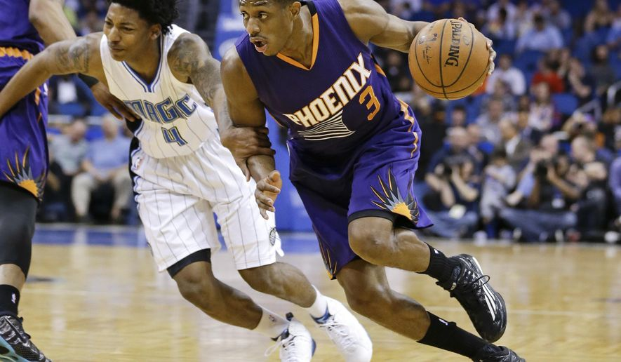 Phoenix Suns' Brandon Knight (3) drives around Orlando Magic's Elfrid Payton (4) during the first half of an NBA basketball game, Wednesday, March 4, 2015, in Orlando, Fla. (AP Photo/John Raoux)