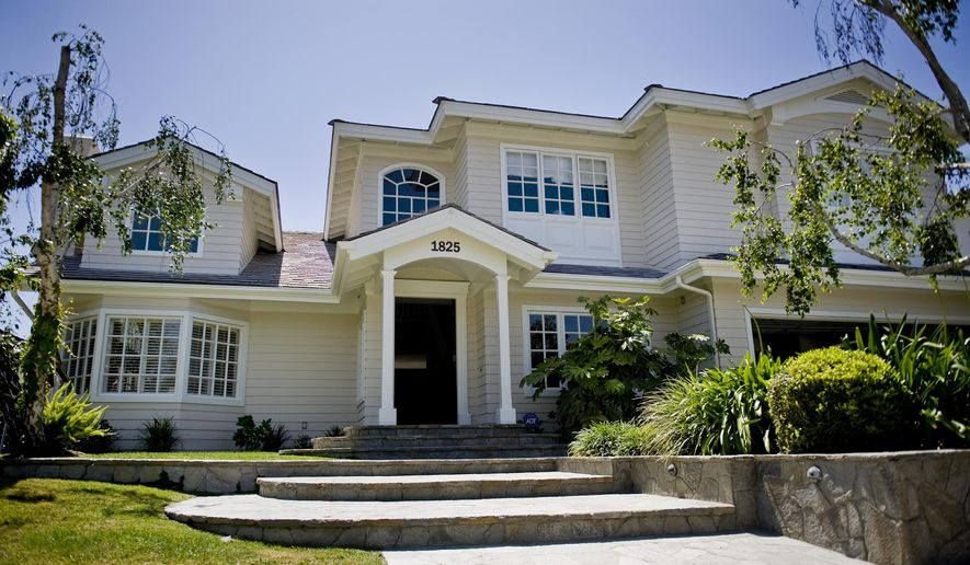 A Thursday, Apr. 23, 2014 photo shows a home bought with allegedly corrupt money from the activities of Chun Doo-hwan, the former President of the Republic of Korea, in Newport Beach, Calif. Relatives of Chun Doo-hwan agreed Wednesday, March 4, 2015, to forfeit $1.2 million in bribery proceeds laundered in the U.S., federal prosecutors said. The forfeiture settlement comes from the Newport Beach, California, house the family sold last year for $2.1 million and an investment they made in a Philadelphia limited partnership.  (AP Photo/The Orange County Register, Anna Reed)   MAGS OUT; LOS ANGELES TIMES OUT