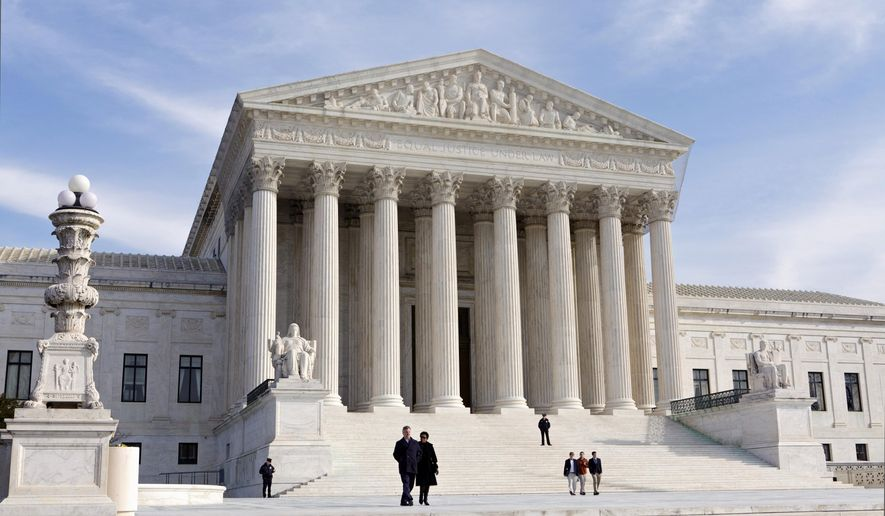The U.S. Supreme Court Building in Washington. The Supreme Court is hearing arguments on March 4, 2015, in a major test of President Barack Obama's health overhaul that threatens insurance coverage for millions of people. The justices are meeting Wednesday to try to determine whether the law makes people in all 50 states eligible for federal tax subsidies to cut the cost of insurance premiums.(AP Photo/J. Scott Applewhite, File)