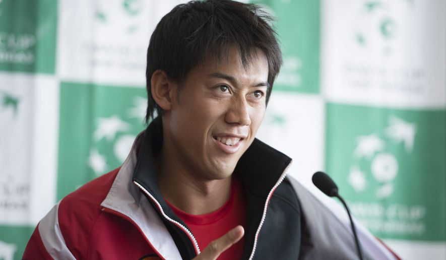 Team Japan's Kei Nishikori gestures during a news conference, Tuesday, March 3, 2015 in Vancouver, British Columbia. Canada will play against team Japan in the Davis Cup this weekend. (AP Photo/The Canadian Press, Jonathan Hayward)
