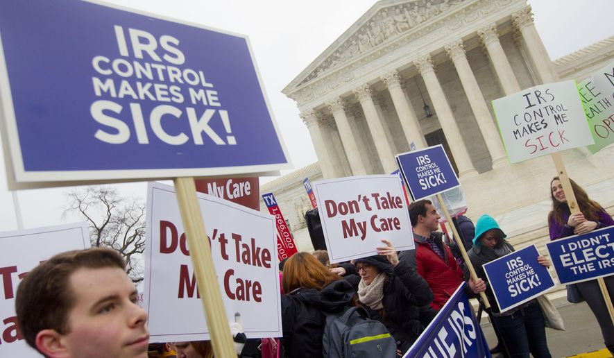 Demonstrators stand outside the Supreme Court in Washington, Wednesday, March 4, 2015, as the court hears arguments in King v. Burwell, a major test of President Barack Obama's health overhaul which, if successful, could halt health care premium subsidies in all the states where the federal government runs the insurance marketplaces. (AP Photo/Pablo Martinez Monsivais)