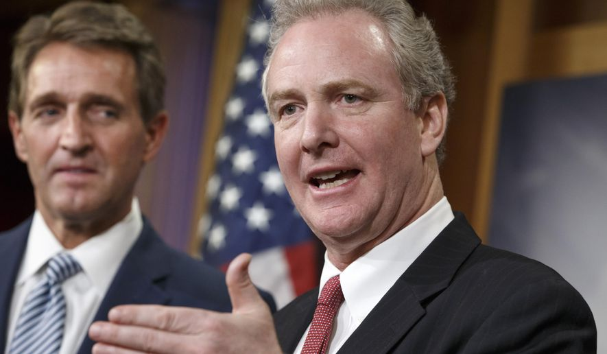 FILE - In this Dec. 17, 2014, file photo, Rep. Chris Van Hollen, D-Md., speaks as Sen. Jeff Flake, R-Ariz. listens during a news conference on Capitol Hill in Washington. Van Hollen says he will run for the Senate seat that will be open when Barbara Mikulski retires. (AP Photo/J. Scott Applewhite, File)
