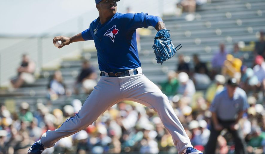 Toronto Blue Jays starting pitcher Marcus Stroman works against the Pittsburgh Pirates during the first inning of a spring training baseball game in Bradenton, Fla., Wednesday, March 4, 2015. (AP Photo/The Canadian Press, Nathan Denette)