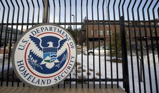 FILE - In this Feb. 25, 2015 file photo, the Homeland Security Department headquarters in northwest Washington, Tuesday, Feb. 24, 2015. on Wednesday, President Barack Obama signed a law funding the Homeland Security Department through the end of the budget year. (AP Photo/Manuel Balce Ceneta, File)