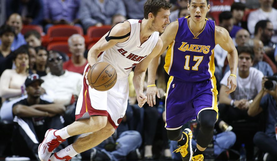 Los Angeles Lakers Jeremy Lin (17) defends against Miami Heat's Goran Dragic (7) during the first half of an NBA basketball game in Miami, Wednesday, March 4, 2015. (AP Photo/Joel Auerbach)