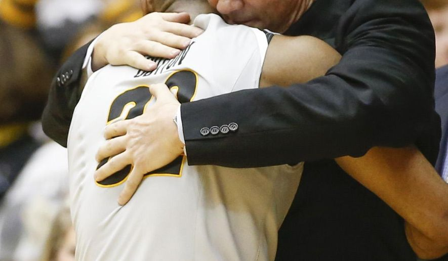 Wichita State coach Gregg Marshall hugs senior guard Tekele Cotton at the end of the Shockers' 74-60 win over Northern Iowa in Wichita, Kan., on Saturday. Wichita State won 74-60 to clinch their second straight Missouri Valley Conference title. (AP Photo/The Wichita Eagle, Travis Heying)