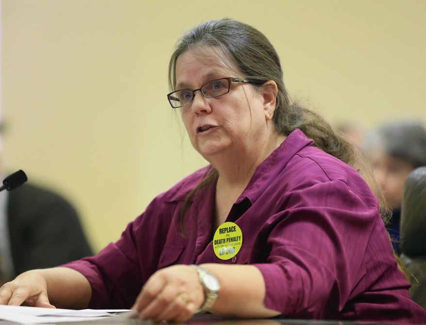 Miriam Thimm Kelle, whose brother James Thimm was tortured and killed on a southeast Nebraska farm in 1985, testifies on a law proposal to change the death penalty to life imprisonment without parole, during a hearing before the Judiciary Committee in Lincoln, Neb., Wednesday, March 4, 2015. (AP Photo/Nati Harnik)
