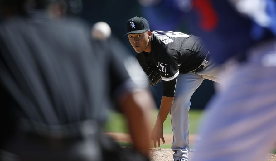 Chicago White Sox's Jose Quintana pitches in the first inning of a spring training exhibition baseball game against the Los Angeles Dodgers, Wednesday, March 4, 2015, in Phoenix. (AP Photo/John Locher)