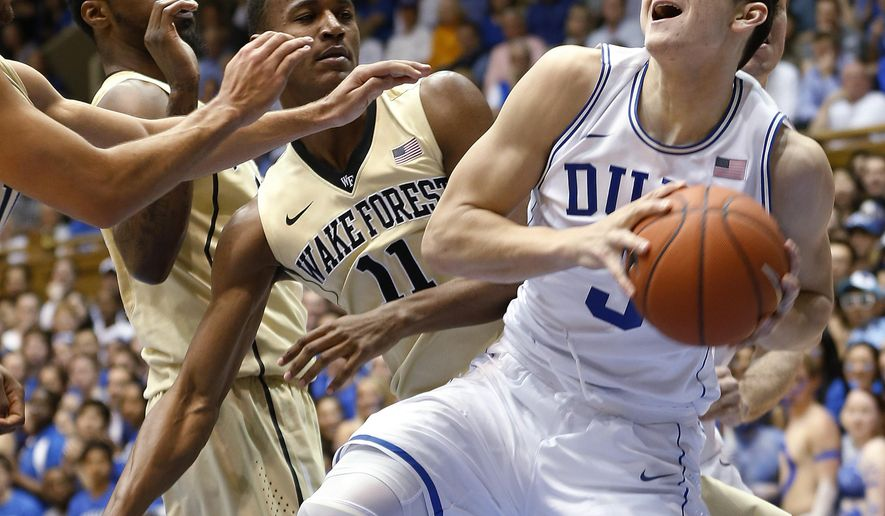 Duke's Grayson Allen (3) looks to go to the basket against Wake Forest's Darius Leonard, left rear, and Greg McClinton (11) during the first half of an NCAA college basketball game Wednesday, March 4, 2015, in Durham, N.C. (AP Photo/Ellen Ozier)