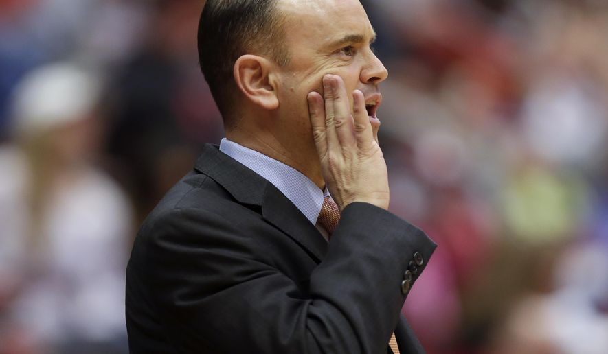 """FILE- In this Feb. 8, 2015, file photo, Oregon State Head Coach Scott Rueck yells instructions to his team on the floor during the second half of an NCAA college basketball game in Pullman, Wash. After Oregon States' Rueck cut down the net to celebrate his team's first regular-season conference title, he was asked whether he thought he'd be here five years ago when he took over a program in shambles. """"Not a chance,"""" he said.  (AP Photo/Gary Breedlove, File)"""