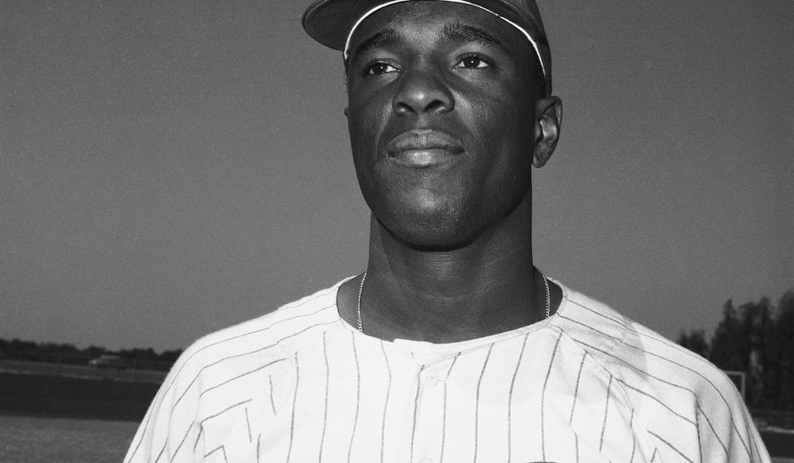 FILE - This is a March 4, 1968, file photo showing Cincinnati Reds outfielder Alex Johnson. Johnson's son, Alex Johnson Jr., said Wednesday, March 4, 2015, that his father died Saturday, Feb. 28, 2015, in Detroit, of complications from prostate cancer.  (AP Photo/Preston Stroup, File)