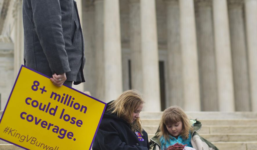 L. Ray Roberts, left stands with his daughters Helena Roberts, 11, center, and her sister Cassie Boyle, 8, right, all from Pittsburgh, on the steps of the Supreme Court in Washington, Wednesday, March 4, 2015, as the court hears arguments in King v. Burwell, a major test of President Barack Obama's health overhaul which, if successful, could halt health care premium subsidies in all the states where the federal government runs the insurance marketplaces. The sisters are holding pictures of their grandmother Hannah Brown, who died when she was 58 years old. Their grandmother lost her job and healthcare and died a year and half later because of lack of access to treatment. (AP Photo/Pablo Martinez Monsivais)