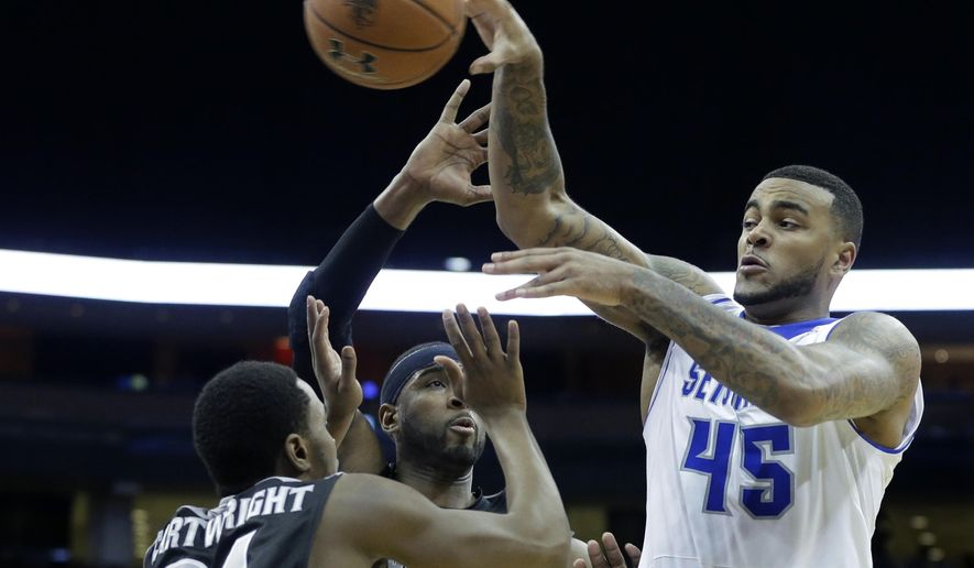 Seton Hall guard Stephane Manga (45), of France, passes over Providence defenders LaDontae Henton (23) Kyron Cartwright (24) during the first half of an NCAA college basketball game Wednesday, March 4, 2015, in Newark, N.J. (AP Photo/Mel Evans)