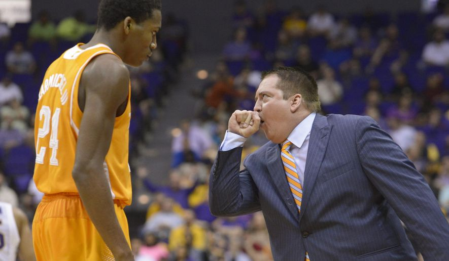 Tennessee's head basketball coach Donnie Tyndall talks to Willie Carmichael during an NCAA college basketball game against LSU, Wednesday, March 4, 2015, in Baton Rouge, La. (AP Photo/The Advocate, Heather McClelland)   MAGS OUT; INTERNET OUT; NO SALES; TV OUT; NO FORNS; LOUISIANA BUSINESS INC. OUT (INCLUDING GREATER BATON ROUGE BUSINESS REPORT, 225, 10/12, INREGISTER, LBI CUSTOM); MANDATORY CREDIT
