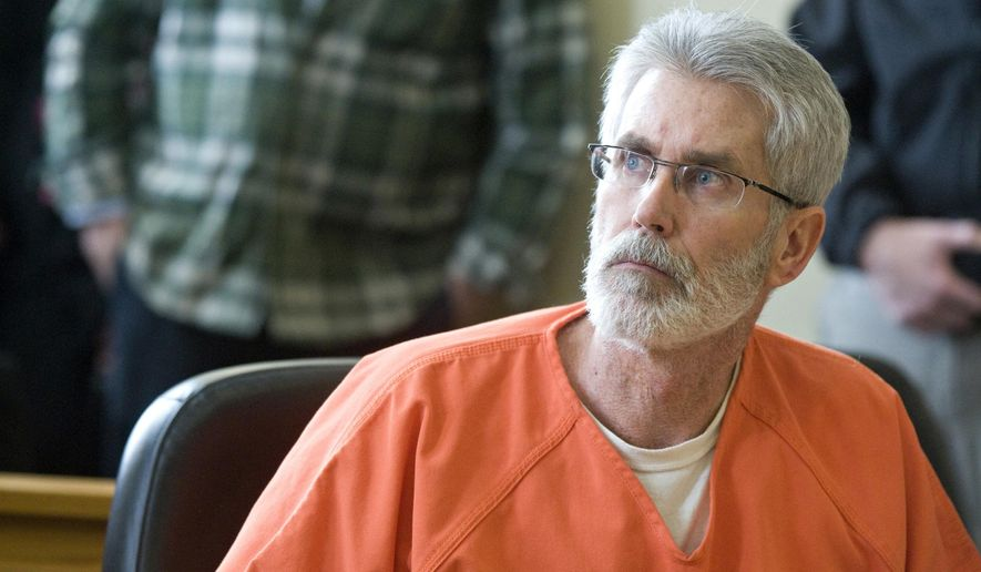 Clarence Gomery sits in court in Traverse City, Mich., Thursday, March 5, 2015, before being sentenced to six to 20 years in prison for his involvement of trying to have another lawyer killed. Grand Traverse County Circuit Judge Philip Rodgers issued the sentence Thursday to Gomery, who pleaded guilty Feb. 6 to solicitation to murder. Gomery has served as a prosecutor in Leelanau and Grand Traverse counties in the northern Lower Peninsula. (AP Photo/Traverse City Record-Eagle, Nathan Payne)