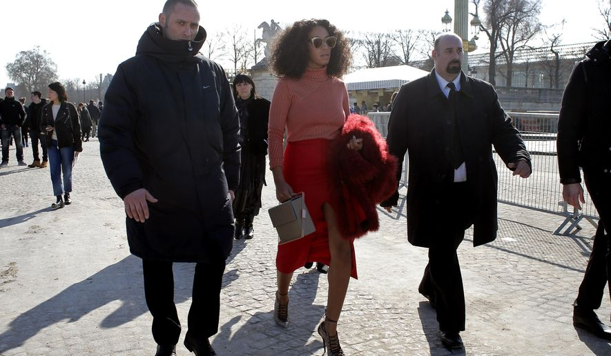 U.S singer Solange Knowles leaves Carven's ready-to-wear fall-winter 2015/2016 fashion collection presented during Paris Fashion Week, in Paris, France, Thursday, March 5, 2015. (AP Photo/Thibault Camus)