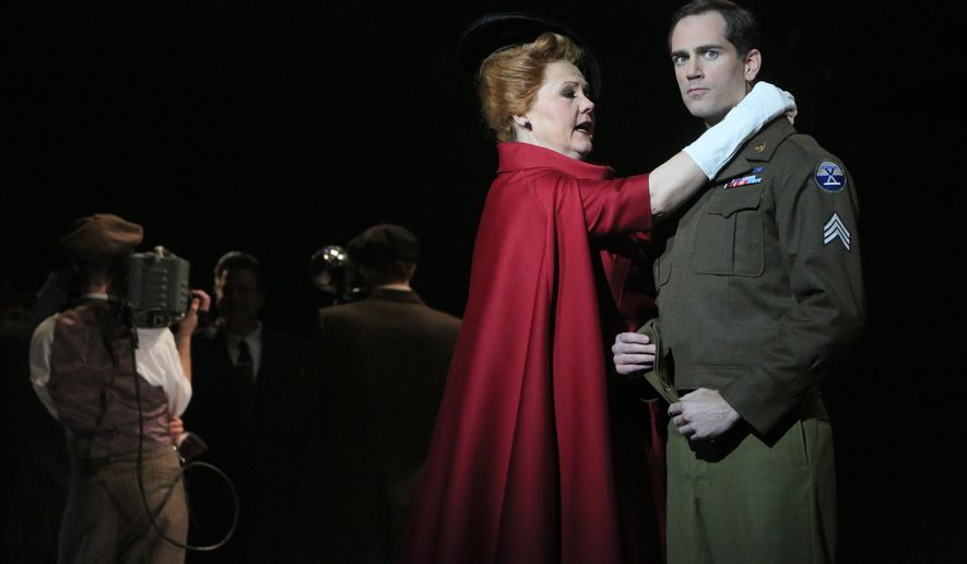 "This image released by the Minnesota Opera shows Brenda Harris as Eleanor Iselin and Matthew Worth as Sergeant Raymond Shaw in the Minnesota Opera production of ""The Manchurian Candidate."" (AP Photo/Minnesota Opera, Michal Daniel)"
