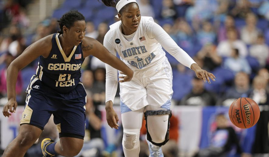 North Carolina's Stephanie Mavunga (1) and Georgia Tech's Zaire O'Neil (21) chase a loose ball during the first half of an NCAA college basketball game in the Atlantic Coast Conference women's tournament in Greensboro, N.C., Thursday, March 5, 2015. (AP Photo/Chuck Burton)