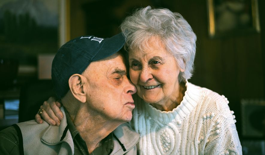 Ed and Jeri NeVille are pictured on Feb. 24, 2015, at their home in Byron, Wyoming, where they first lived as newlyweds in the early 1930s. They have been married since Nov. 25, 1933.  (AP Photo/Powell Tribune, Carla Wensky)