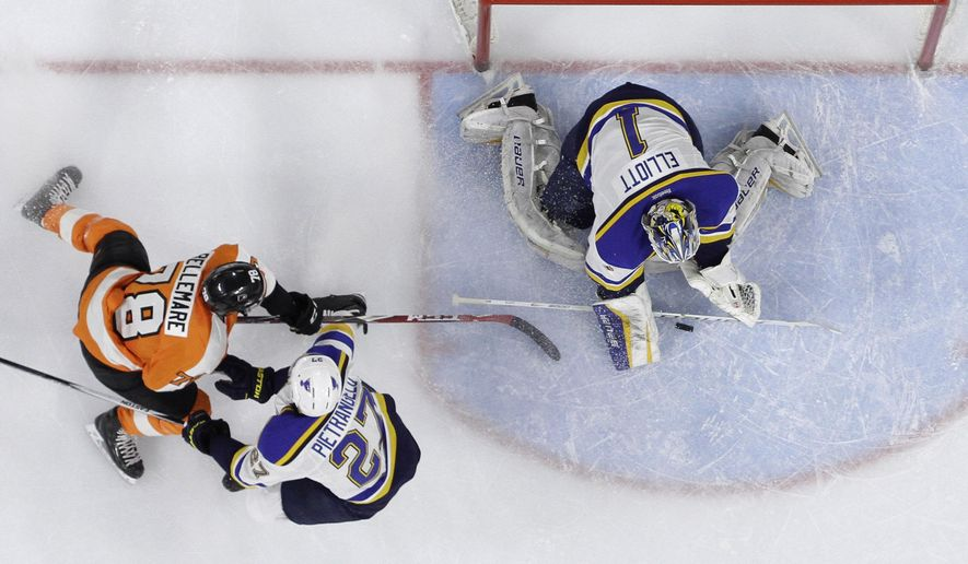Philadelphia Flyers' Pierre-Edouard Bellemare (78) tries to get a shot past St. Louis Blues' Brian Elliott (1) and Alex Pietrangelo (27) during the second period of an NHL hockey game, Thursday, March 5, 2015, in Philadelphia. (AP Photo/Matt Slocum)