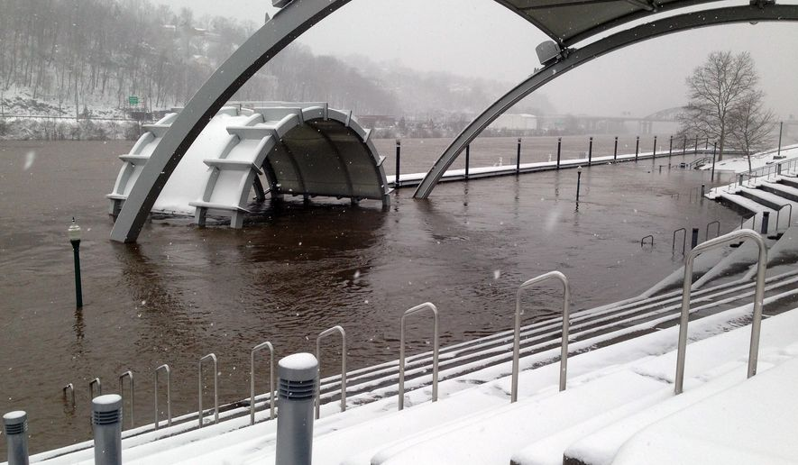 CORRECTS MONTH - A pavilion used for summer concerts and other events in downtown Charleston, W.Va., is flooded by the Kanawha River on Thursday, March 5, 2015. Heavy rains followed by snow have pushed streams and rivers out of their banks across West Virginia. (AP Photo-John Raby)