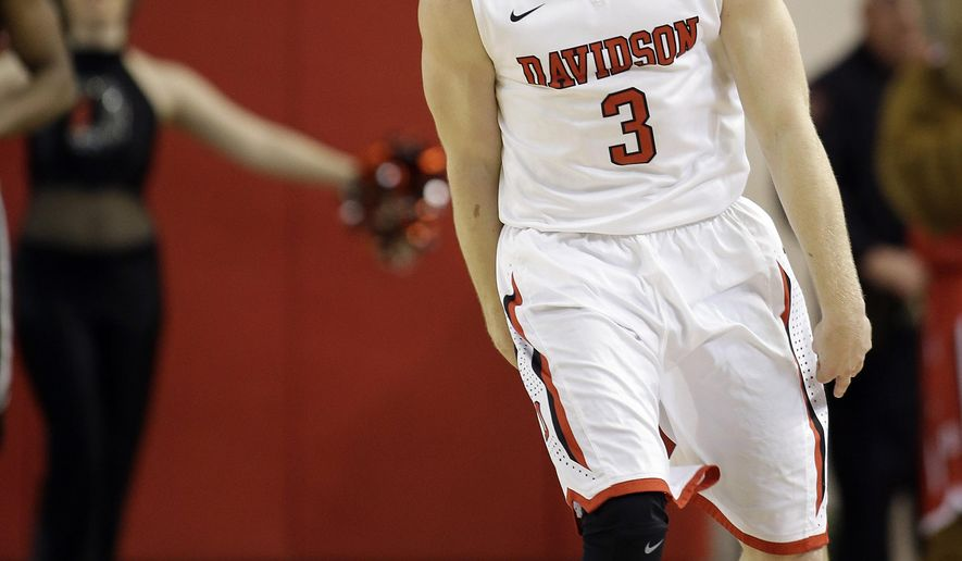 Davidson's Brian Sullivan celebrates his 3-pointer against Virginia Commonwealth during the first half of an NCAA college basketball game in Davidson, N.C., Thursday, March 5, 2015. (AP Photo/Bob Leverone)