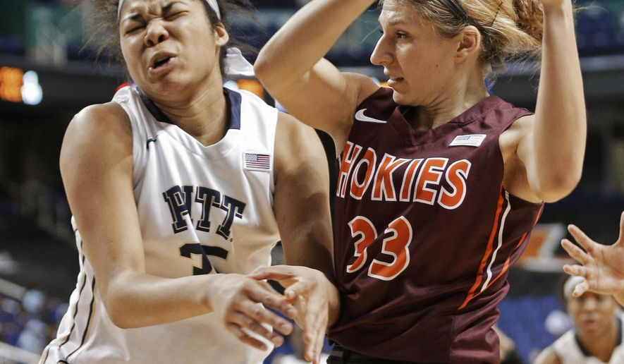 Pittsburgh's Stasha Carey (35) is hit by Virginia Tech's Kelsey Conyers (33)  during the second half of an NCAA college basketball game in the Atlantic Coast Conference women's tournament in Greensboro, N.C., Thursday, March 5, 2015. Virginia Tech won 51-45. (AP Photo/Chuck Burton)