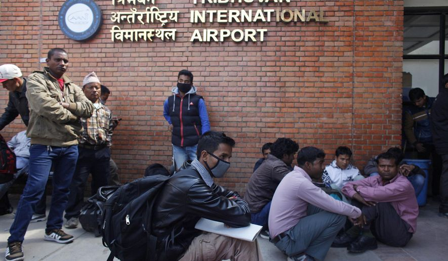 Stranded passengers wait for an update on their flights at Tribhuwan International Airport in Kathmandu, Nepal, Wednesday, March 4, 2015. A Turkish Airlines jet landing in dense fog in the Nepalese capital Wednesday skidded off a slippery runway but there were no serious injuries, officials said. The only international airport in Nepal remained closed Wednesday morning after the accident. (AP Photo/Niranjan Shreshta)