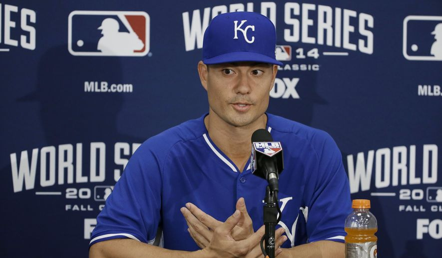 FILE - In this Oct. 23, 2014, file photo, Kansas City Royals starting pitcher Jeremy Guthrie gestures while answering questions  during a news conference in San Francisco. In the world of sneakerheads, a subculture of folks whose pursuit of the latest kicks sometimes borders on the obsessive, Guthrie is something just short of a deity. He's been accumulating shoes since he was a kid, when he got his first pair of Air Jordans, and his vast collection held in a vault in his Utah home has grown to roughly 500 pairs. (AP Photo/Eric Risberg, File)
