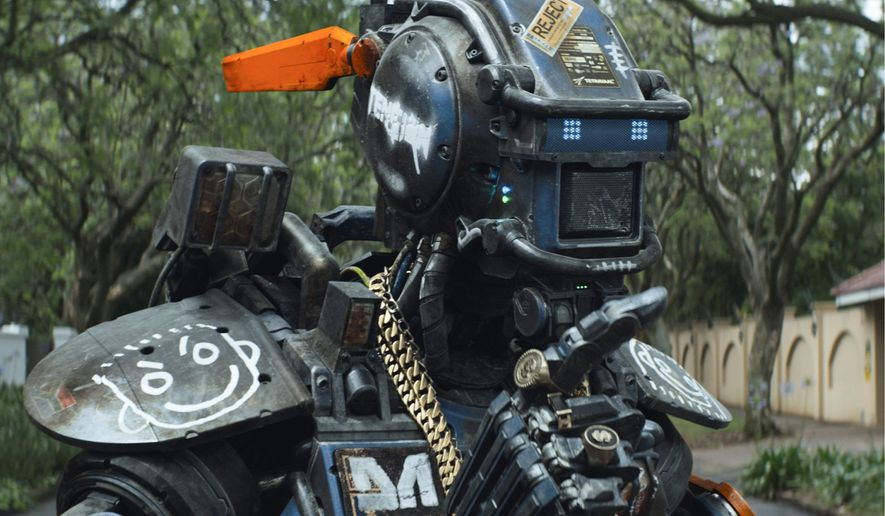 """""""Chappie,"""" featuring a police robot, appears to be cobbled together from """"Robocop,"""" """"Short Circuit"""" and even Neill Blomkamp's distinctly original sci-fi film of 2009, """"District 9."""" The most clever part of the movie doesn't come until the very end. (Associated Press)"""