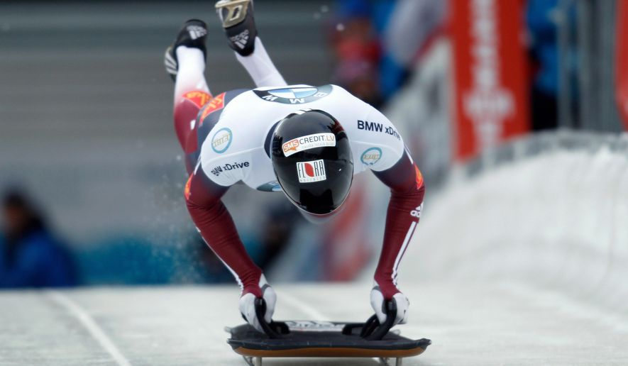 Skeleton athlete Martins Dukurs of Latvia starts his first run during the bob and skeleton World Championships in Winterberg, Germany, Thursday, March(AP Photo/dpa, Ina Fassbender)